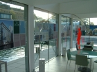 Double sided lightfast panels applied direct to glass