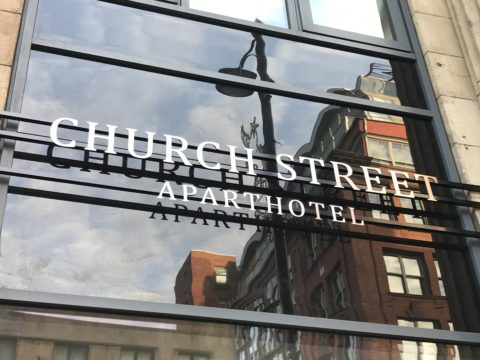 Fret cut, brushed steel sign – Aparthotel, Manchester
