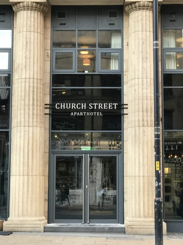 Fret cut, brushed steel sign – Aparthotel, Manchester